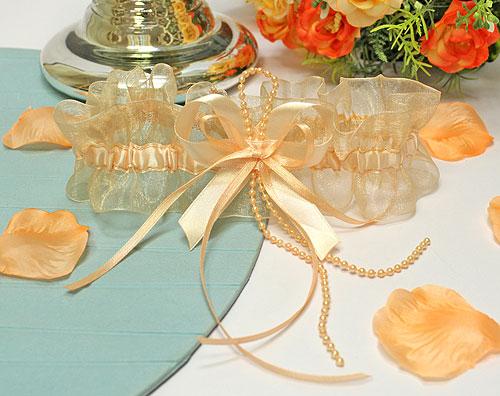 """Подвязка для невесты """"Бантики"""" (персик)"""