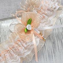 """Свадебная подвязка """"Озорные сердечки"""" (персиковый)"""